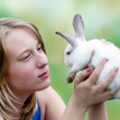 Easter rabbit in hands of the young girl — Stock Photo