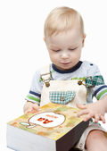 Cute little boy reading a book — Stock Photo