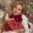 Happy Girl with Presents near the Christmas tree — Foto de Stock