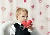 Valentine's Day - cute child with red Heart in hands. — Stock Photo