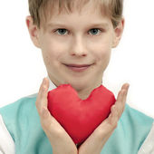 Smiling boy with red Heart in hands. — Stock Photo