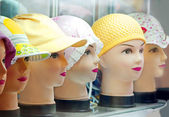 Showcase with fashionable hats — Stock Photo