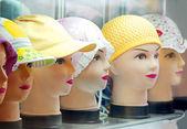 Showcase with fashionable hats — Stock Photo