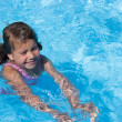 Stock Photo: Girl swims.