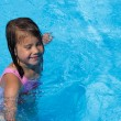 Stock Photo: Girl swims. It's fun to swim