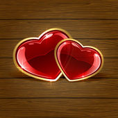 Two hearts on wooden background — Stock Vector