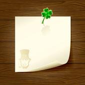 用纸和三叶草的木制背景 — 图库矢量图片