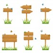 Set of wooden signs in grass — Stock Vector #45760187