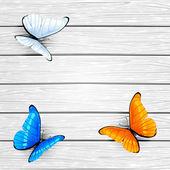 Three butterflies on wooden background — Stock Vector