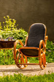Rocking chair in the garden — Stok fotoğraf
