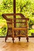 Rattan Chair near a large window — Stock Photo
