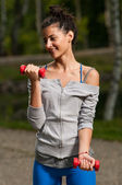 Woman working out and smiling — Stock Photo