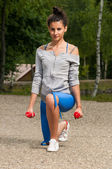 Woman in the park exercising — Stock Photo