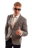 Young funky businessman showing thumbs up — Stock Photo