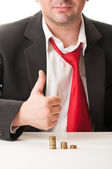 Business man showing ok sign with piles of coin — Stock Photo