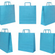 Various blue shopping bags on different possitions — Stock Photo