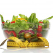 Stock Photo: Healthy salad and measuring tape isolated