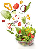 Falling fresh vegetables. Healthy salad isolated — Stock Photo