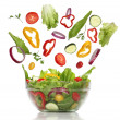 Stock Photo: Falling fresh vegetables. Healthy salad isolated