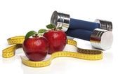 Red apples and a measuring tape over white — Stock Photo