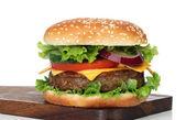 Tasty hamburger isolated on white — Stock Photo