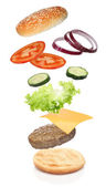 Flying ingredients of hamburger isolated — Stock Photo