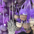 Dried lavender petals in small baskets, violet decoration - Stock Photo