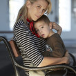 Beautiful blonde woman and her little son together — Stock Photo