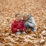 Two boys in autumn park — Stock Photo #34904963