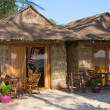 Straw house on a beach in Cambodia - Stock Photo