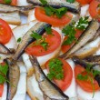 Sandwiches with sprats on a plate — Stock Photo #12214383
