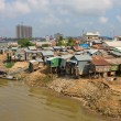 Poor district in Phnom Penh, Cambodia - Stock Photo