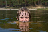 Children in water closeup — Stockfoto