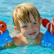 Стоковое фото: Little girl in the swimming pool