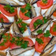 Sandwiches with sprats on a plate — Stock Photo #13366152
