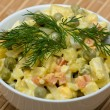 Russian traditional salad under the name Olivier — Stock Photo