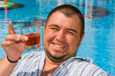 Big man drinking alcohol — Stock Photo