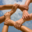 Many hands connecting to a chain with sky — Stock Photo #13622042