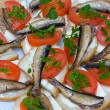 Sandwiches with sprats on a plate — Foto Stock