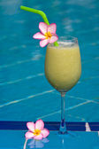 Fruit shake at the swimming pool — Stock Photo