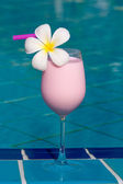 Berry shake at the swimming pool — Stock Photo