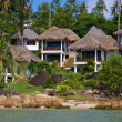 Tropical house on the beach — Stock Photo #19049605