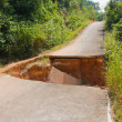 Break of asphalt road in Thailand - Stock Photo