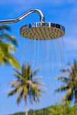 Shower on the background of blue sky — Stock Photo