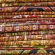 Heap of cloth fabrics at a local market in India. — Stockfoto
