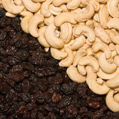 Cashew and black raisins — Stock Photo