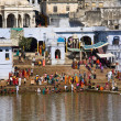 PUSHKAR, INDIA - NOVEMBER 18: at ritual washing in the holy lake on November 18,2012 in Pushkar, India. A ritual bath in the lake is considered to lead one to salvation. — Stock Photo