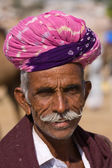 PUSHKAR, INDIA - NOVEMBER 18: An unidentified man attends the Pushkar Camel Mela on November 18, 2012 in Pushkar, Rajasthan, India. This fair is the largest camel trading fair in the world. — Stock Photo