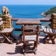 Table and chairs with a beautiful sea view , Thailand. - Stock Photo