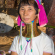 Foto Stock: Portrait of Karen long neck hill tribe girl at village,BHuay sue towhere tourist daily visiting in Mae Hong Son, Thailand on November 10, 2011